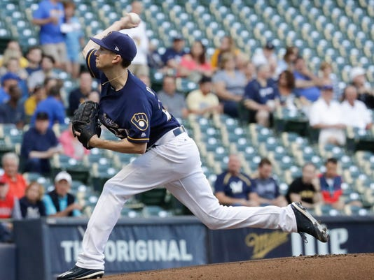 Milwaukee Brewers' Zach Davies throws during the first inning of a baseball game against the Pittsburgh Pirates Tuesday, June 20, 2017, in Milwaukee. (AP Photo/Morry Gash)