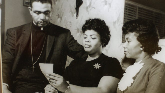 This photo of Linda Brown, center, pictured with her parents, hangs in the hall at Central High School.