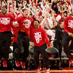In this Sunday, March 16, 2014 photo, Nebraska players react seconds after the NCAA Selection Show announced Nebraska's spot in the NCAA tournament bracket at a watch party in Lincoln, Neb. (AP Photo/The Journal-Star, Morgan Spiehs)