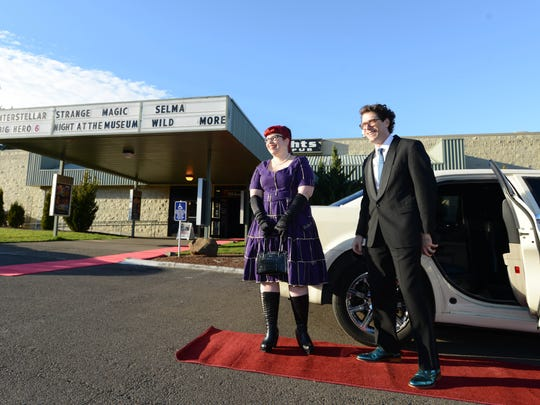 Statesman Journal reporters Carlee Wright and Tom Mayhall Rastrelli wait for guests to arrive during Tom and Carlee's C.A.F.E. Oscars Viewing Party at Northern Lights Theatre Pub. The limo from Starlight Limousine served as a photo prop.