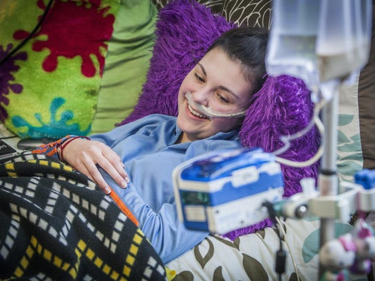 Lauren McGlaughlin, 13 years old at the time in this file photo, rests at home in March 2015. McGlaughlin suffers from a condition known as POTS, which left her bed-ridden.