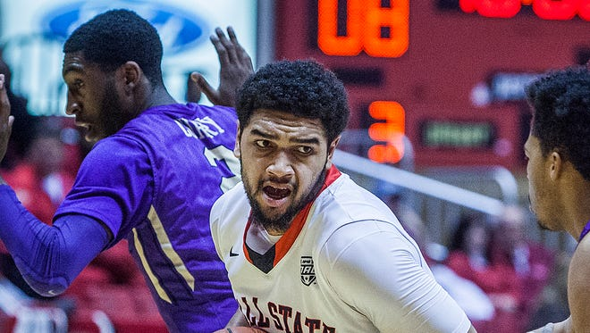 Ball State's Franko House struggles against James Madison's defense during their game at Worthen Arena Wednesday.