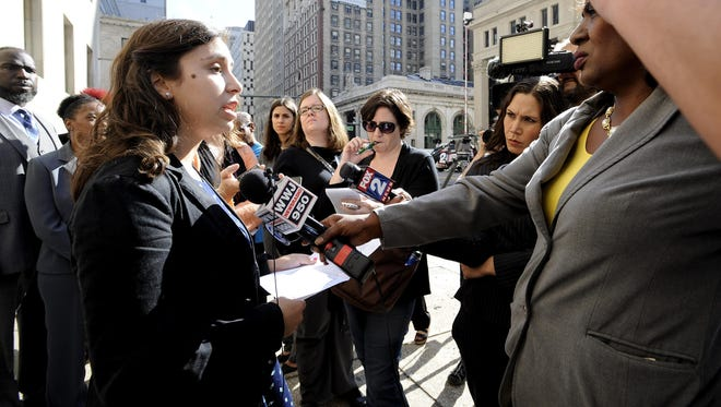 Renee Schenkman of Detroit, a former teacher at Experiencia Preparatory Academy, talks to the media in Detroit on Tuesday about a lawsuit challenging literacy efforts in schools.