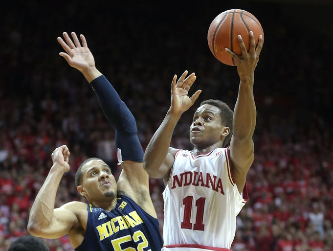 Indiana's Yogi Ferrell drives on Michigan's Jordan Morgan,left, in the second half of their game Sunday, January 2, 2014, afternoon at Assembly Hall in Bloomington IN. The Hoosiers defeated the Wolverines 63-52.