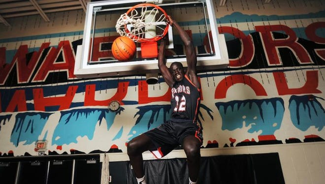 Washington High's Deng Geu shows how he plays above the rim. The North Dakota State recruit is the Argus Leader Media/Sanford Pentagon First Five boys player of the year.