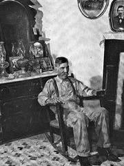 Don Roberto Brady sits beneath the portrait of his father, Sheriff William J. Brady, a victim of Billy the Kid. Don Roberto 's son also was a Lincoln County sheriff. The photo appeared in LIFE magazine.