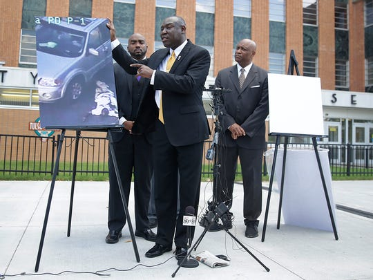 Attorney Benjamin Crump, center, one of the attorneys for Crutcher's family, speaks about Terence Crutcher during a news conference about the shooting death of Crutcher Tuesday, Sept. 20, 2016 in Tulsa, Okla. Crutcher, was shot by a Tulsa Police officer on Friday night. Also pictured are attorneys David Riggs, left, Damario Solomon-Simmons and Melvin C. Hall.