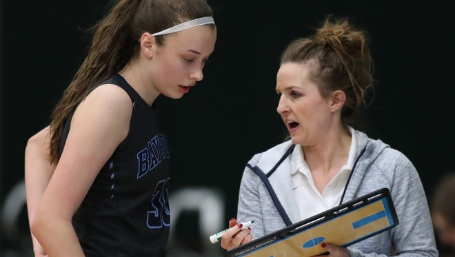 Bay Port coach Kati Coleman coaches Mady Draak during a game against Green Bay Preble on Feb. 9. Bay Port enters the AP state rankings this week at No. 10 in Division 1.