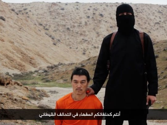 A screengrab from a video showing Japanese hostage