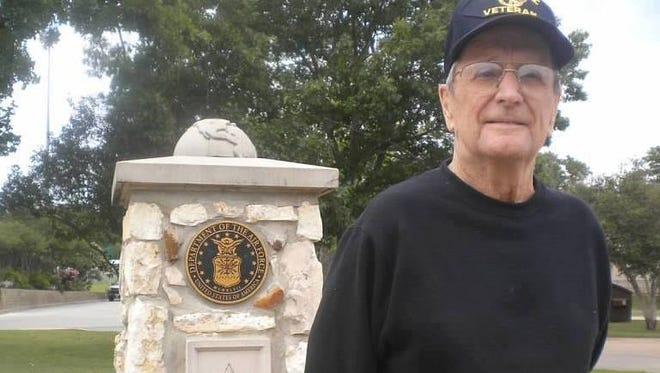 Gay Huddle's father, Bobby Gombash, in front of his United States Air Force military monument in Brenham, Texas.  He was a proud World War II veteran, one of many to honor at the Veterans' Day Parade in downtown Ithaca and at the Veterans' Day ceremony in Dewitt Park.