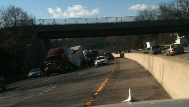 A tractor-trailer collapsed on itself near Exit 3 on eastbound I-287.