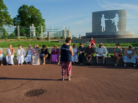 "Director Toni Schapperjohn (center) gives instruction to the Evansville Shakespeare Players before rehearsal for ""A Midsummer Night's Dream,"" at the Pagoda Monday evening."