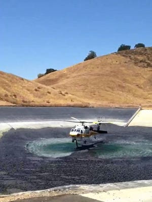 Black shade balls in the Recycled Water Resevoir at the Las Virgenes Municipal Water District in Calabasas, Calif. still allow for helicopters to use the water.