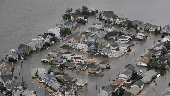 This aerial photo from Oct. 30, 2012, shows flooding caused by superstorm Sandy on the bay side of Seaside Heights.