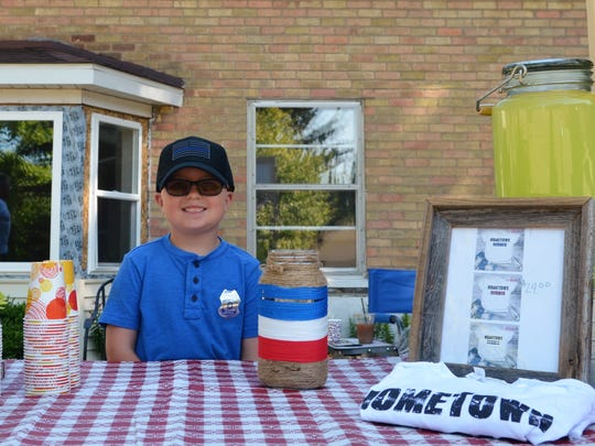 Michael McNabb, 7, raised money for Tri-Hospital EMS' Shop With a Hero program on July 8, 2018, in Lexington, Michigan.