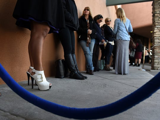 Lynette Fernandes and her stylish shoes line up with fellow shoppers to take advantage of the opening of a new Nordstrom Rack clothing store in Reno on March 26, 2015.