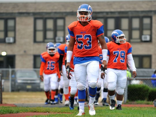 Millville football Thunderbolt Tyler Ramos (53) before
