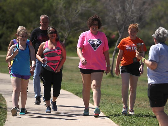 Walkers join in on the Mayor's Wellness Partnership walk that kicked off the first mile of the Walk Across Texas program at Kirby Park Sunday, March 19, 2017.