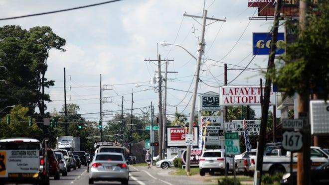 Motorists travel south Tuesday, September 30, 2014, on Johnston Street in Lafayette, La.