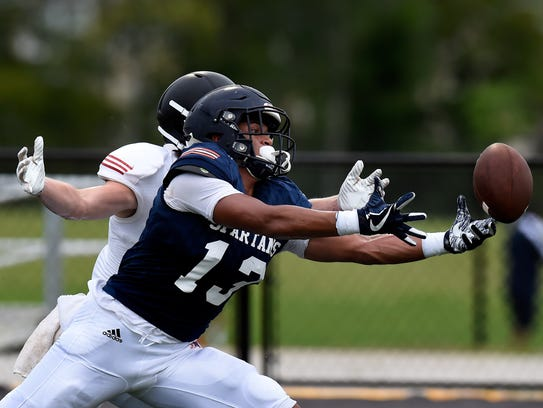 Summit  defensive back Tai Carter (13) breaks up a