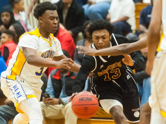 Washington forward Shakur Cottman (13) drives into the Wicomico defense at the Waller Dome on Tuesday evening in Bayside South action.