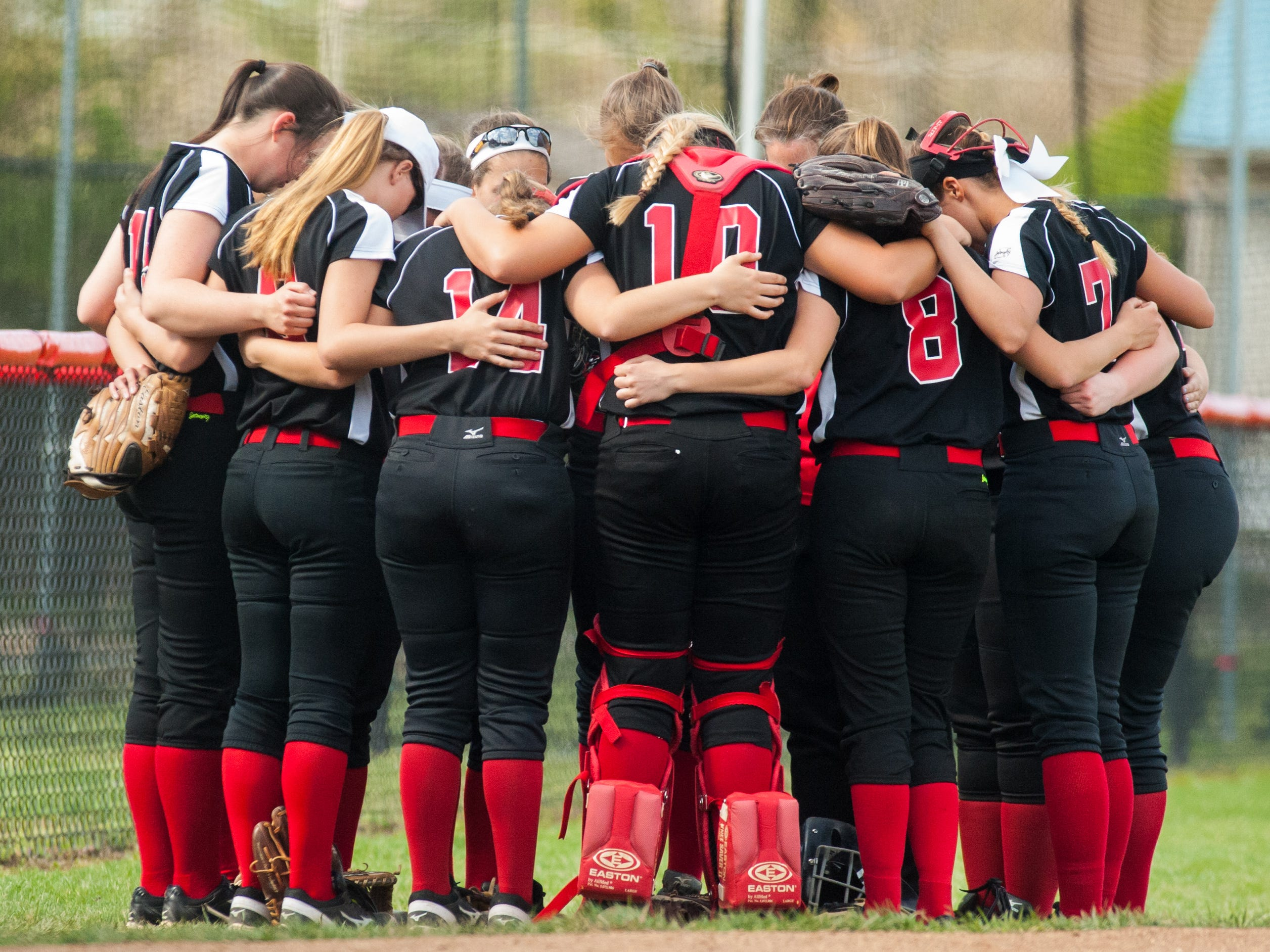 The James M. Bennett softball team prepares for a game against Parkside at James M Bennett High on Thursday afternoon.