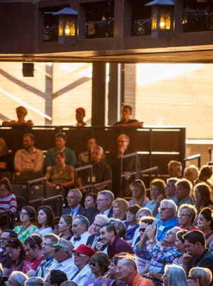 "The audience for the Utah Shakespeare Festival's production of ""Henry V"" listens to speakers during the Thursday evening dedication ceremony for the Engelstad Shakespeare Theatre in Cedar City."