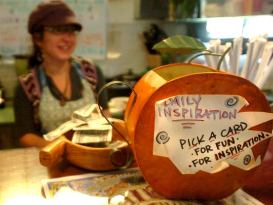 A watering can filled with inspirational notes sits on the counter Saturday at Under One Sun at Central Market in York.