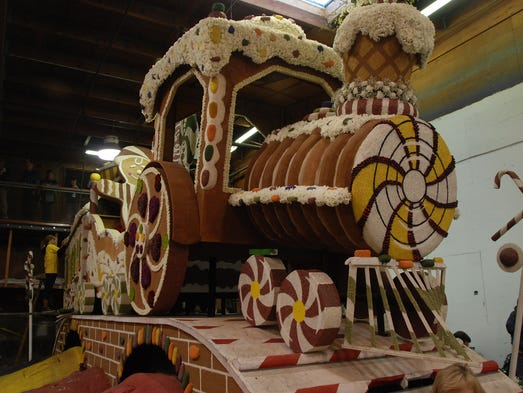 A volunteer works on the Rotary Rose Parade float for the 125th Tournament of Roses Parade on Dec. 30 in the Rosemont building in Pasadena, Calif. The parade will be held on Jan. 1.