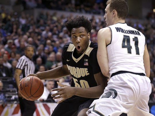 Purdue Boilermakers forward Caleb Swanigan (50) works on Michigan State Spartans forward Colby Wollenman (41) in the first half of their Big Ten Men's Basketball Tournament championship game Sunday, at Bankers Life Fieldhouse.