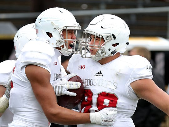 Brandon Knight,right, celebrates his touchdown with Nick Westbrook (15) in the Old Oaken Bucket game.