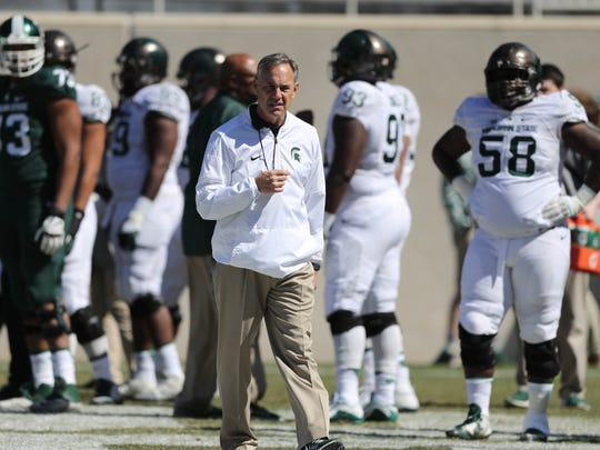 Michigan State head coach mark Dantonio watches the