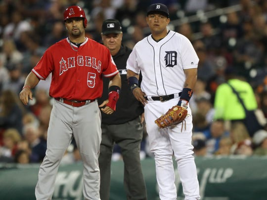 Tigers' Miguel Cabrera and Angels' Albert Pujols at first base during the seventh inning Wednesday, June 7, 2017 at Comerica Park in Detroit.
