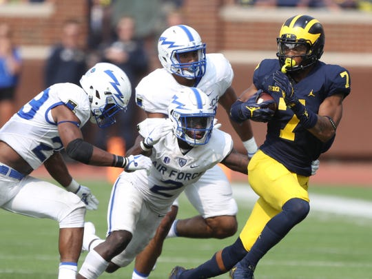 Michigan's Tarik Black runs away from Air Force defenders