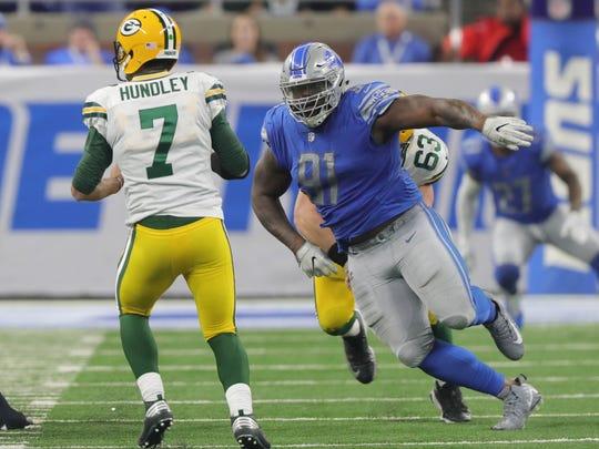 A'Shawn Robinson rushes Packers QB Brett Hundley last season.