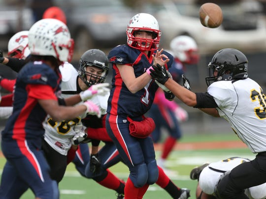 Liggett's Connor McCarron pitches the ball to Thomas Jackson during first half action against Everett Collegiate Academy on Saturday, October 18, 2014.