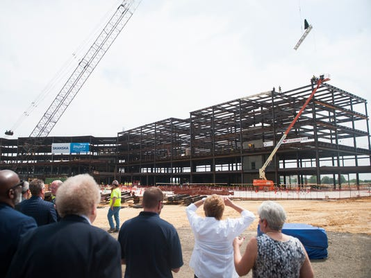 Workers top steel frame at Inspira Mullica Hill