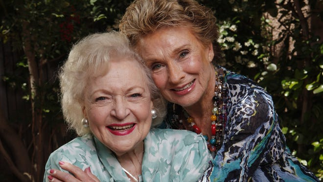 """Cloris Leachman and Betty White pose for a photo shoot at the Beverly Hills Hotel in Beverly Hills, CA. The two Mary Tyler Moore Show alums were flying high in two hotly anticipated summer films: Betty White is a naughty 90-year-old """"gammy"""" in the comedy The Proposal and Cloris Leachman in the Quentin Tarntino WWII filme Inglourious Basterds."""