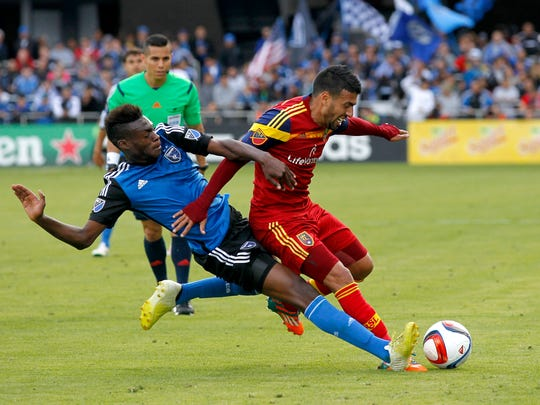San Jose Earthquakes midfielder Fatai Alashe (27) attempts to kick the ball away from Real Salt Lake midfielder Javier Morales (11) in the second half at Avaya Stadium. The Real Salt Lake defeated the Earthquakes 1-0.