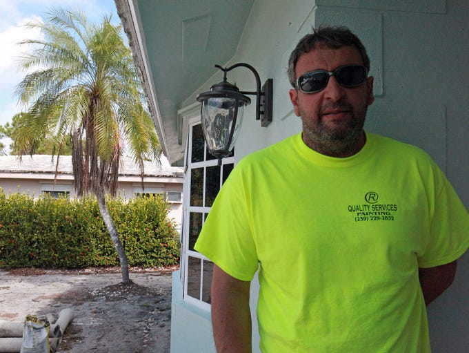 Painting contractor Costa Rodrigo takes time out on