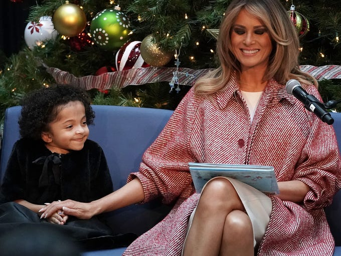 First lady Melania Trump shares a moment with Tearrianna