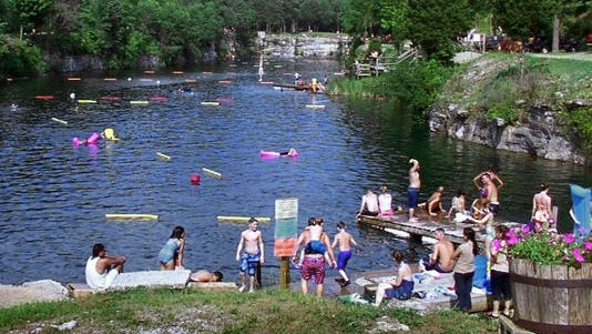 People enjoy the day at White Rock Park's main lake near St. Paul, Ind.