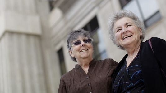 In this March 10, 2014, file photo Jennie, 72, left, and Nancy Rosenbrahn, 68, stand outside the Pennington County Courthouse in Rapid City. The Rapid City couple plans to be among the first South Dakotans to challenge the state's ban on same-sex marriage.