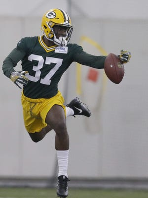 Second-round draft choice Josh Jackson (37) participates in a drill during the Packers' rookie camp Friday, May 4, 2018 at the Don Hutson Center.