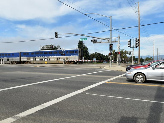 An Amtrak train passes through the intersection of