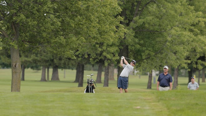 Collin Schroeder hits a fairway shot in the Oshkosh City Golf Tournament at Lakeshore Municipal Golf Course in August 2016.