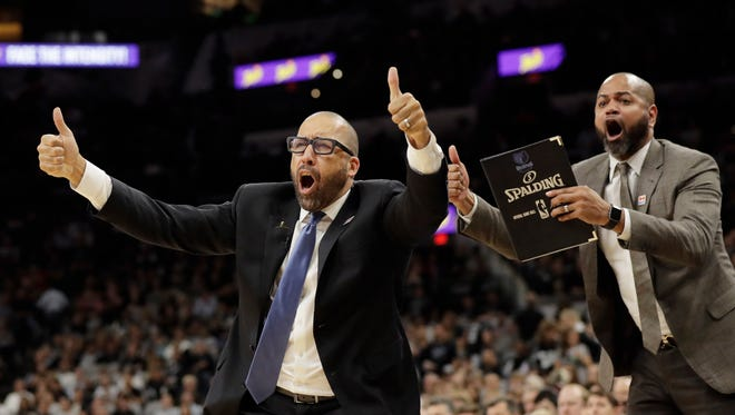Memphis Grizzlies head coach David Fizdale, left, and assistant J.B. Bickerstaff, right, argue a call during the second half in Game 2 of a first-round NBA basketball playoff series against the San Antonio Spurs, Monday, April 17, 2017, in San Antonio. San Antonio won 96-82.(AP Photo/Eric Gay)