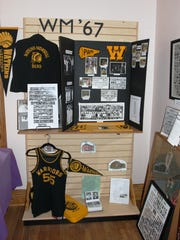 A display showing items from the Watkins Memorial class of 1967.
