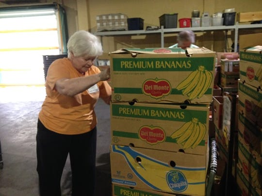 Linda Mitchell works in the Fort Myers warehouse of the Harry Chapin Food Bank