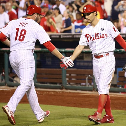Aug 26, 2014; Philadelphia, PA, USA; Philadelphia Phillies left fielder Darin Ruf (18) is congratulated by left fielder Grady Sizemore (24) after hitting a home run during the sixth inning of a game against the Washington Nationals at Citizens Bank Park. The Phillies defeated the Nationals 4-3. Mandatory Credit: Bill Streicher-USA TODAY Sports